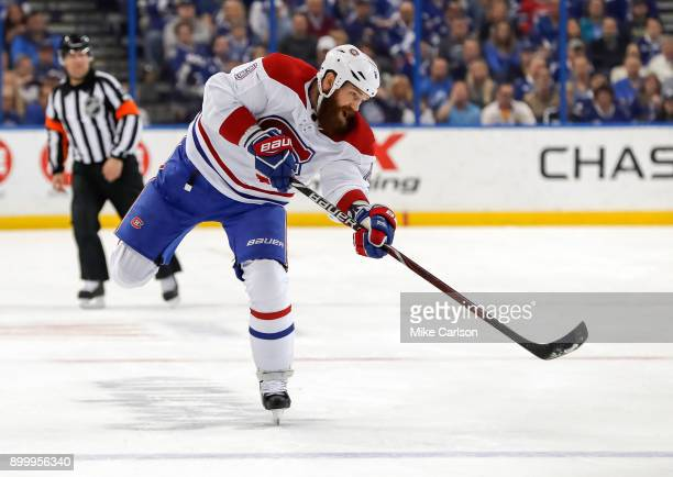 Jordie Benn of the Montreal Canadiens shoots against the Tampa Bay Lightning during the first period at Amalie Arena on December 28 2017 in Tampa...