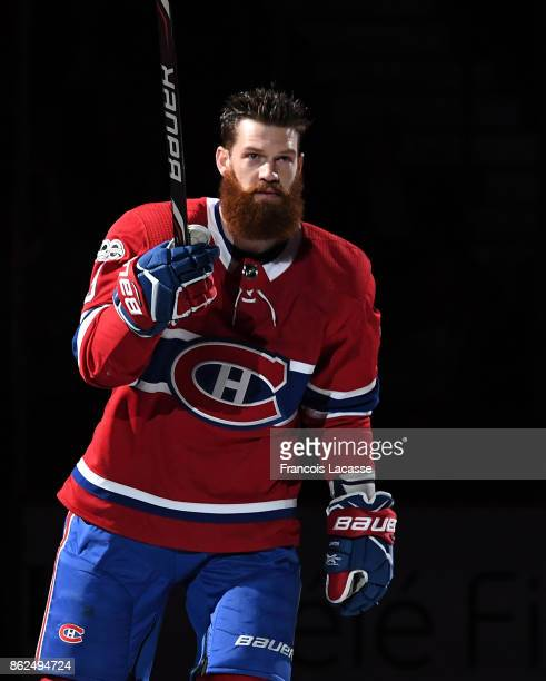 Jordie Benn of the Montreal Canadiens skates during the game presentation prior the NHL game against the Chicago Blackhawks at the Bell Centre on...