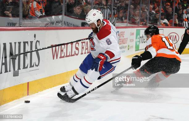 Jordie Benn of the Montreal Canadiens skates the puck along the boards against Corban Knight of the Philadelphia Flyers on March 19 2019 at the Wells...