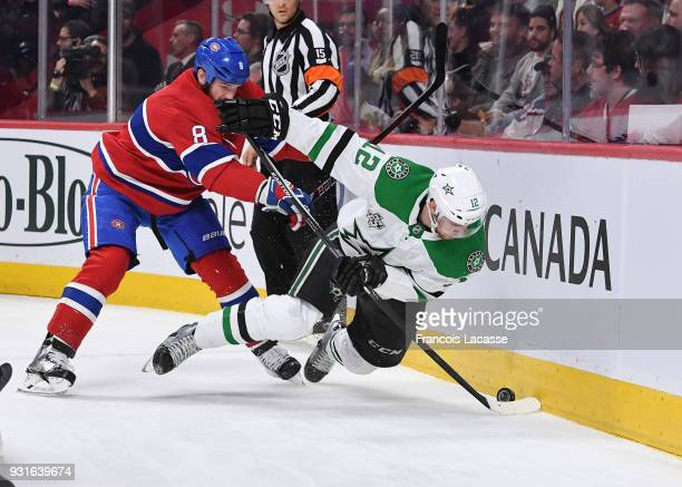 Jordie Benn of the Montreal Canadiens stick checks Radek Faksa of the Dallas Stars in the NHL game at the Bell Centre on March 13 2018 in Montreal...