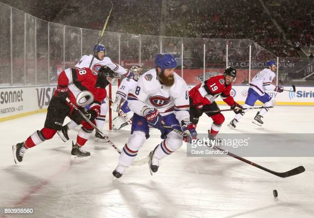 Jordie Benn of the Montreal Canadiens stickhandles the puck with Ryan Dzingel and Derick Brassard of the Ottawa Senators chasing during the 2017...