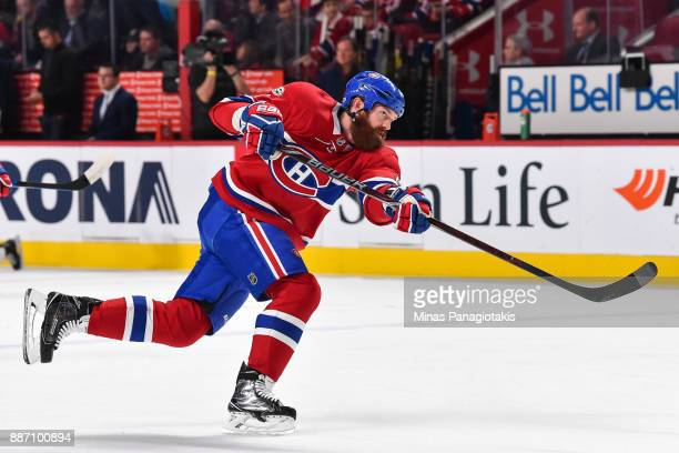 Jordie Benn of the Montreal Canadiens takes a shot during the warmup prior to the NHL game against the Detroit Red Wings at the Bell Centre on...