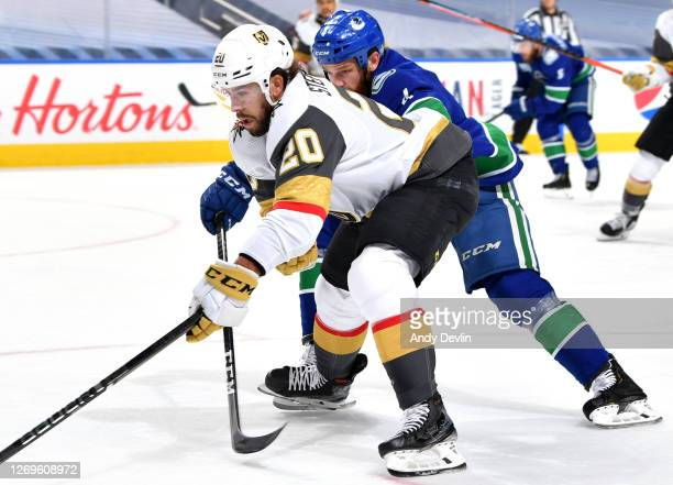 Jordie Benn of the Vancouver Canucks defends Chandler Stephenson of the Vegas Golden Knights during the third period of Game Three of the Western...
