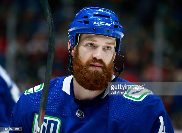Jordie Benn of the Vancouver Canucks looks on from the bench during their NHL game against the Detroit Red Wings at Rogers Arena October 15, 2019 in...