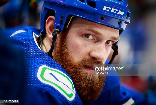 Jordie Benn of the Vancouver Canucks looks on from the bench during their NHL game against the Florida Panthers at Rogers Arena October 28, 2019 in...