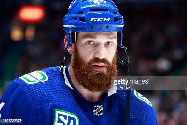 Jordie Benn of the Vancouver Canucks looks on from the bench during their NHL game against the Ottawa Senators at Rogers Arena December 3, 2019 in...