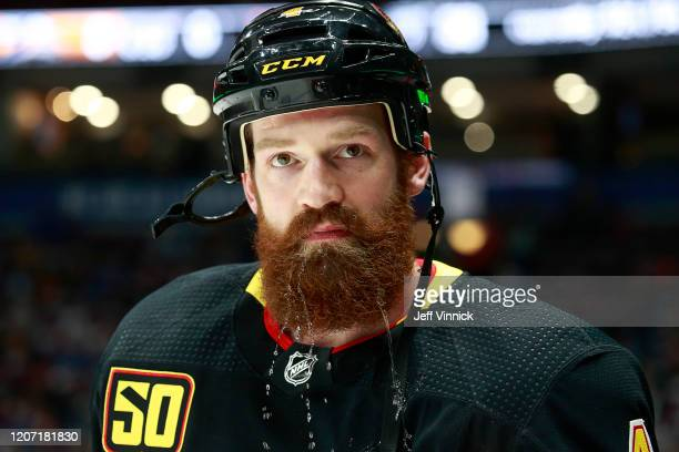 Jordie Benn of the Vancouver Canucks looks on from the bench during their NHL game against the Nashville Predators at Rogers Arena February 10, 2020...