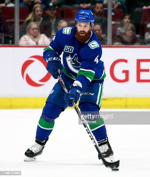 Jordie Benn of the Vancouver Canucks skates up ice during their NHL game against the Dallas Stars at Rogers Arena November 14, 2019 in Vancouver,...