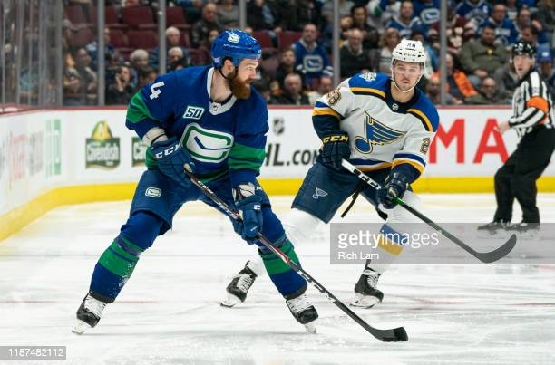 Jordie Benn of the Vancouver Canucks skates with the puck during NHL action against the St. Louis Blues at Rogers Arena on November 5, 2019 in...