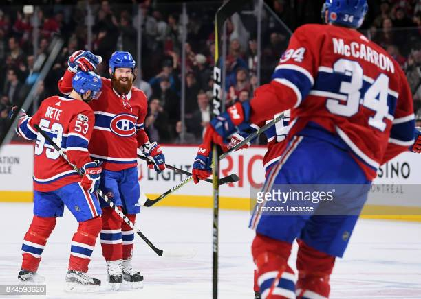 Jordie Benn Victor Mete and Michael McCarron of the Montreal Canadiens celebrate a goal against the Vegas Golden Knights in the NHL game at the Bell...