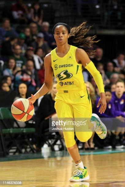 Jordin Canada of the Seattle Storm brings the ball up the court against the Phoenix Mercury on May 25 2019 at the Angel of the Winds Arena in Everett...