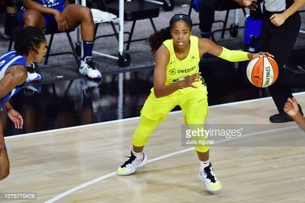 Jordin Canada of the Seattle Storm dribbles during the first half against the Minnesota Lynx in Game One of their Third Round playoff at Feld...