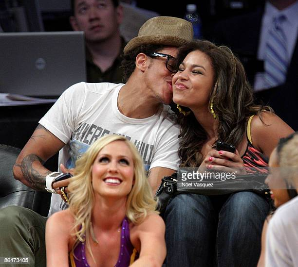 Jordin Sparks and Steph Jones kiss at the Los Angeles Lakers vs Houston Rockets game at Staples Center on May 6 2009 in Los Angeles California