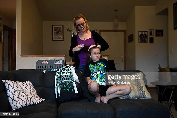 Jordin Terry does her daughter Jeleena's hair before taking her to cheerleading practice in Fort Collins 10 miles away on Wednesday June 8 2016 Terry...