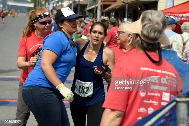 Jordin Thompson receives assistance following her race during the Women's Division of the 91st Running of the Mount Marathon Race on July 4 2018 in...