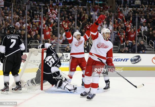 Jordin Tootoo and Drew Miller of the Detroit Red Wings celebrate a goal by teammate Kyle Quincey in the first period against the Los Angeles Kings at...