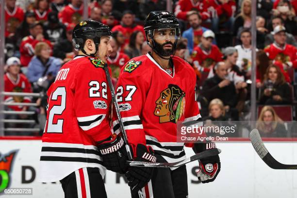 Jordin Tootoo and Johnny Oduya of the Chicago Blackhawks wait for play to begin in the first period against the Anaheim Ducks at the United Center on...