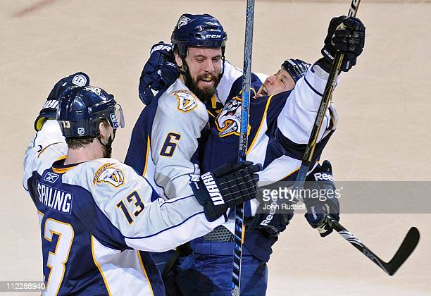 Jordin Tootoo celebrates his goal with Shea Weber and Nick Spaling of the Nashville Predators against the Anaheim Ducks in Game Three of the Western...