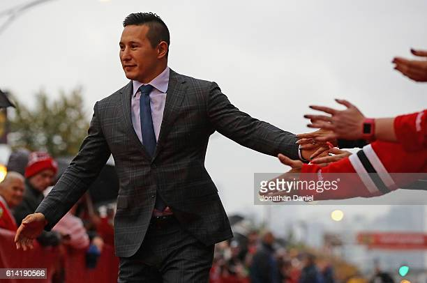 Jordin Tootoo of the Chicago Blackhawks greets fans during a redcarpet even before the season opening gameagainst the St Louis Blues at the United...