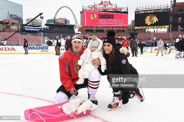 Jordin Tootoo of the Chicago Blackhawks left and guests skate during the family skate as part of the 2017 Bridgestone NHL Winter Classic at Busch...