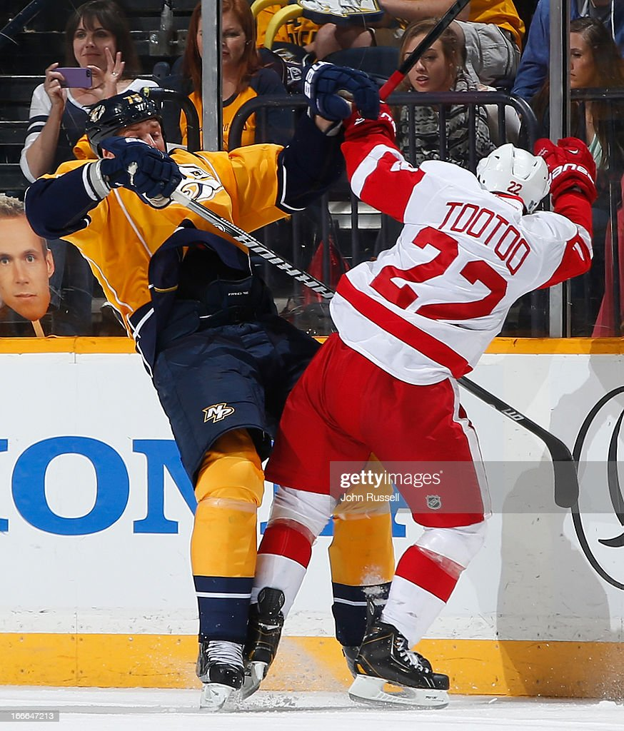 Jordin Tootoo #22 of the Detroit Red Wings checks Hal Gill #75 of the Nashville Predators during an NHL game at the Bridgestone Arena on April 14, 2013 in Nashville, Tennessee.