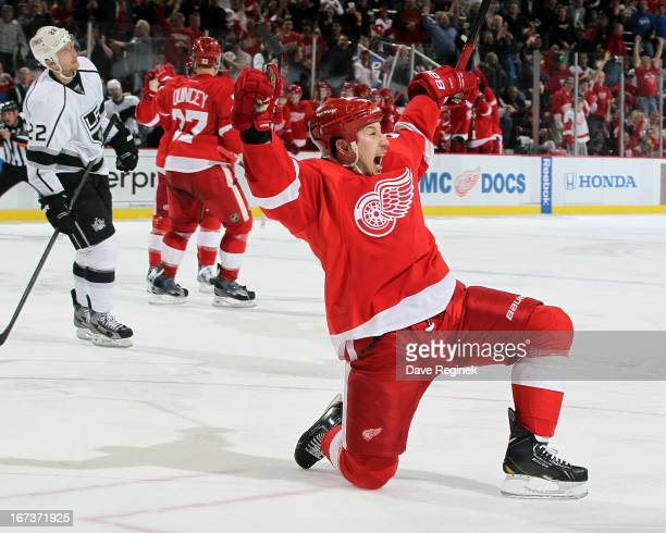 Jordin Tootoo of the Detroit Red Wings drops to one knee and celebrates after scoring a goal as Trevor Lewis of the Los Angeles Kings can only watch...