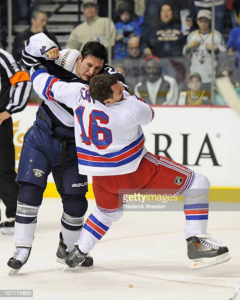 Jordin Tootoo of the Nashville Predators fights Sean Avery of the New York Rangers on November 27 2010 at the Bridgestone Arena in Nashville Tennessee