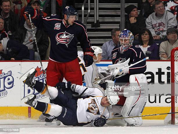 Jordin Tootoo of the Nashville Predators is dumped by Jan Hejda of the Columbus Blue Jackets at the Nationwide Arena on December 1 2010 in Columbus...