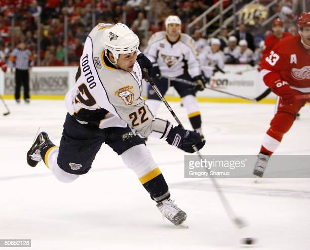 Jordin Tootoo of the Nashville Predators takes a slap shot in front of Kris Draper of the Detroit Red Wings during game two of the 2008 NHL Western...