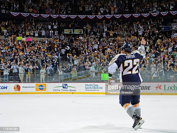 Jordin Tootoo of the Nashville Predators waves to fans after defeating the Anaheim Ducks in Game Six of the Western Conference Quarterfinals during...