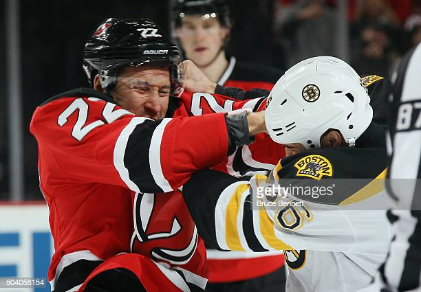 Jordin Tootoo of the New Jersey Devils and Zac Rinaldo of the Boston Bruins fight during the first period at the Prudential Center on January 8 2016...