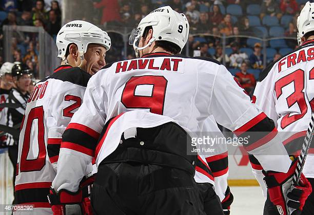 Jordin Tootoo of the New Jersey Devils celebrates his goal against the Buffalo Sabres with teammate Martin Havlat at First Niagara Center on March 20...