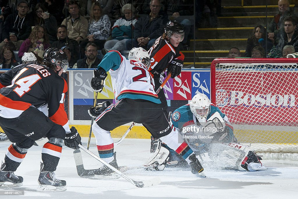 Jordon Cooke #30 of the Kelowna Rockets makes a save against the Medicine Hat Tigers on January 24, 2014 at Prospera Place in Kelowna, British Columbia, Canada.
