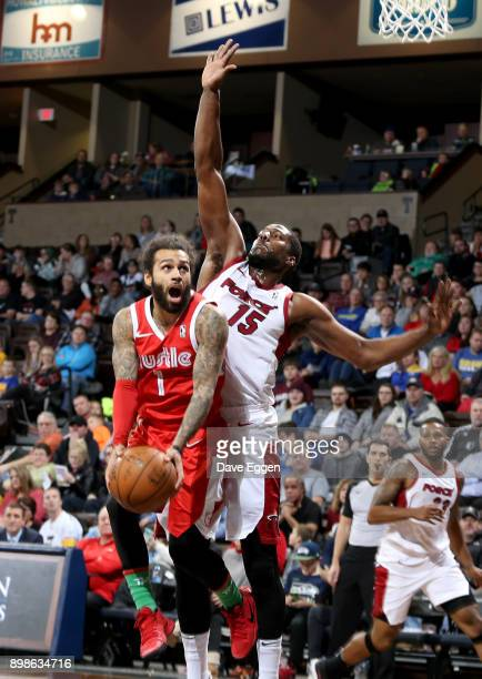 Jordon Crawford of the Memphis Hustle is fouled while taking the ball to the basket by Tony Mitchell of the Sioux Falls Skyforce during an NBA...