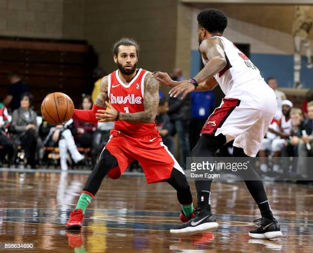 Jordon Crawford of the Memphis Hustle looks to pass the ball around the defense of Larry Drew II of the Sioux Falls Skyforce during an NBA GLeague...