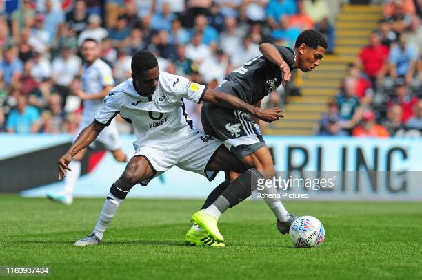 Jordon Garrick of Swansea City vies for possession with Jude Bellingham of Birmingham City during the Sky Bet Championship match between Swansea City...
