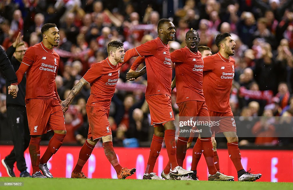 Jordon Ibe, Alberto Moreno, Christian Benteke, Mamadou Sakho and Emre Can of Liverpool celebrates at the end of the Capital One Cup Semi Final: Second Leg between Liverpool and Stoke City at Anfield on January 26, 2016 in Liverpool, England.