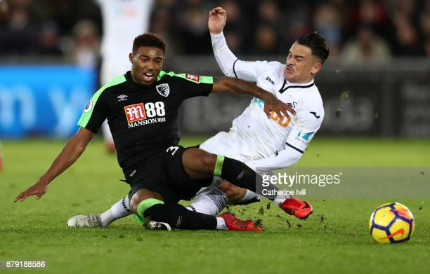 Jordon Ibe of AFC Bournemouth and Roque Mesa of Swansea City during the Premier League match between Swansea City and AFC Bournemouth at Liberty...