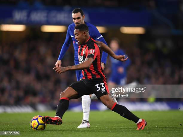 Jordon Ibe of AFC Bournemouth and runs with the ball under pressure from Davide Zappacosta of Chelsea during the Premier League match between Chelsea...