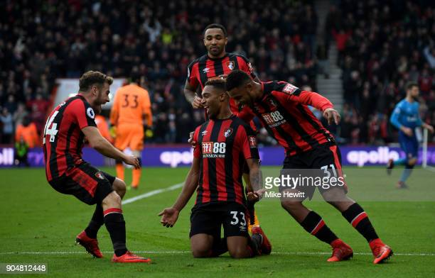 Jordon Ibe of AFC Bournemouth celebrates with team mates after scoring the second AFC Bournemouth goal during the Premier League match between AFC...
