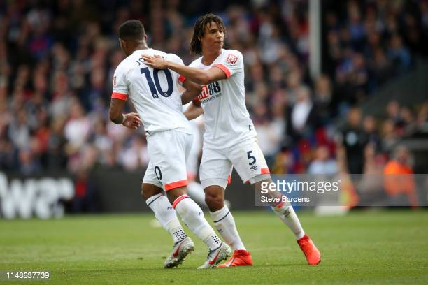 Jordon Ibe of AFC Bournemouth celebrates with teammate Nathan Ake after scoring his team's second goal during the Premier League match between...
