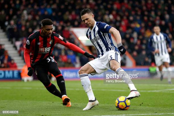 Jordon Ibe of AFC Bournemouth challenges Kieran Gibbs of West Bromwich Albion during the Premier League match between AFC Bournemouth and West...