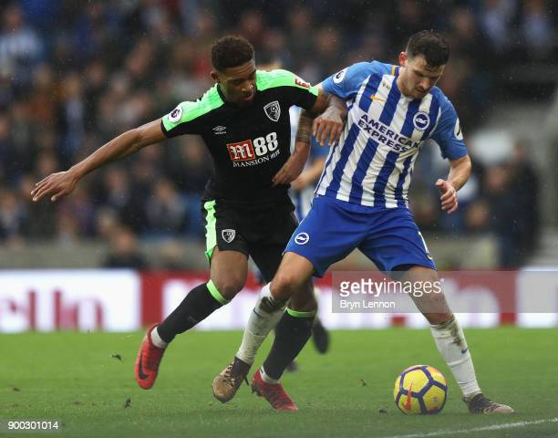 Jordon Ibe of AFC Bournemouth challenges Pascal Gross of Brighton and Hove Albion during the Premier League match between Brighton and Hove Albion...