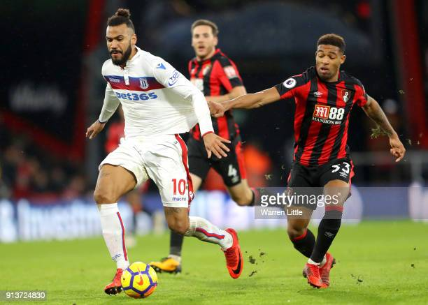 Jordon Ibe of AFC Bournemouth chases down Maxim ChoupoMoting of Stoke City during the Premier League match between AFC Bournemouth and Stoke City at...
