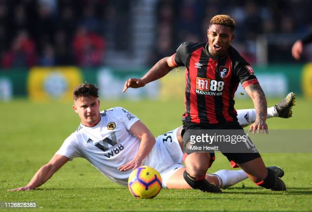 Jordon Ibe of AFC Bournemouth is challenged by Leander Dendoncker of Wolverhampton Wanderers during the Premier League match between AFC Bournemouth...