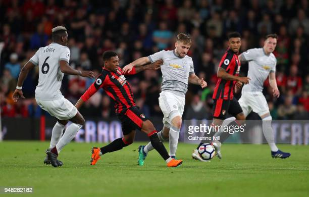 Jordon Ibe of AFC Bournemouth tackles Luke Shaw of Manchester United during the Premier League match between AFC Bournemouth and Manchester United at...