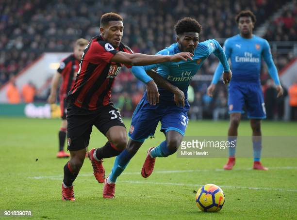 Jordon Ibe of Bournemouth is challenged by Ainsley MaitlandNiles of Arsenal during the Premier League match between AFC Bournemouth and Arsenal at...
