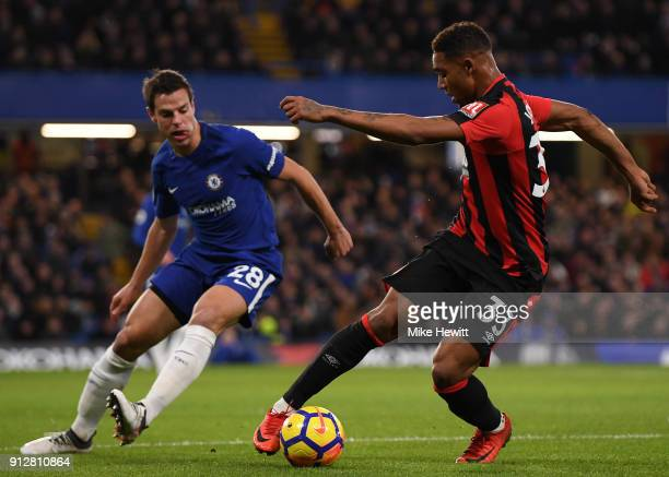Jordon Ibe of Bournemouth is challenged by Cesar Azpilicueta of Chelsea during the Premier League match between Chelsea and AFC Bournemouth at...