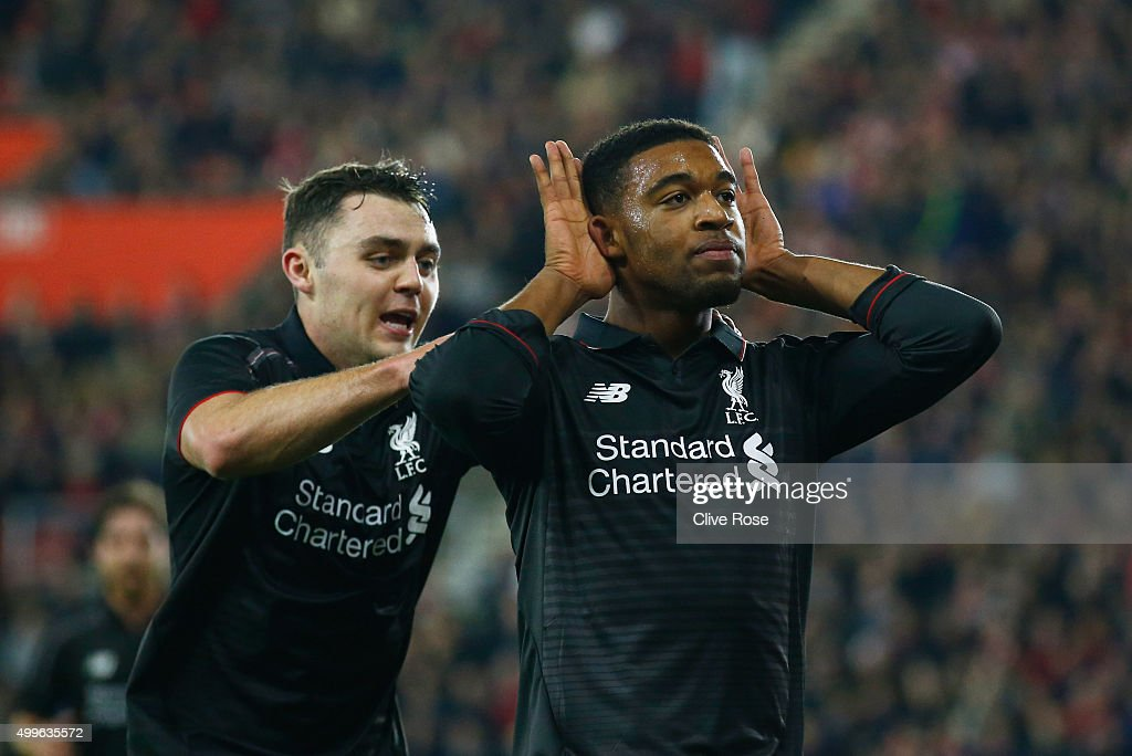 Jordon Ibe of Liverpool (R) celebrates with Connor Randall as he scores their fifth goal during the Capital One Cup quarter final match between Southampton and Liverpool at St Mary's Stadium on December 2, 2015 in Southampton, England.