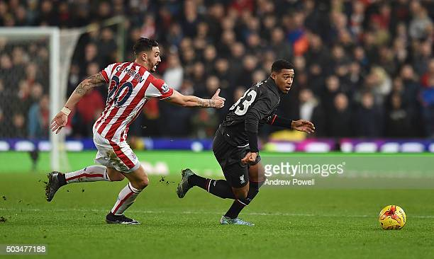 Jordon Ibe of Liverpool competes with Geoff Cameron of Stoke City during the Capital One Cup semi final first leg match between Stoke City and...